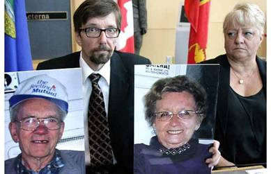 "Bret McCann, left, the eldest son of the missing St. Albert couple Lyle and Marie Ann McCann, holds pictures of his parents during a newsc onference at Edmonton's ""K"" Division RCMP headquarters on Tuesday, July 13, 2010. Bret's wife, Mary-Ann McCann is at right. The seniors are missing after leaving St. Alb"